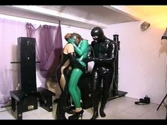 Big breasted slave girl in latex being humiliated by a horny couple Thumb