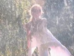 sexy brunette dancing in the rain Thumb